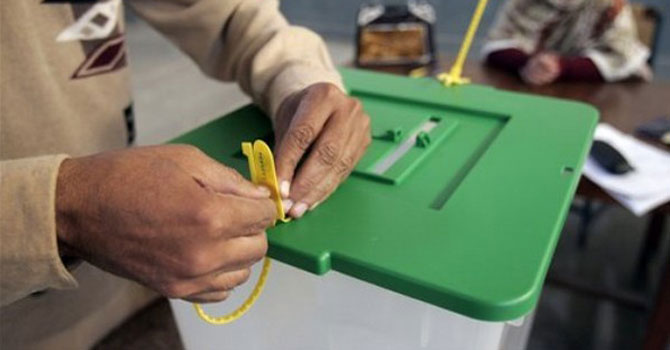 Election worker sealing up a ballot box at a voting booth